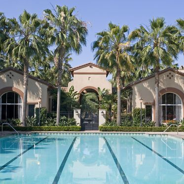 Exterior view of pool at Estancia Apartment Homes in Irvine, CA.