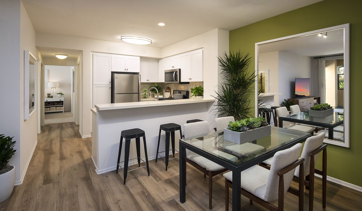 Interior view of kitchen and dining room at Las Palmas Apartment Homes in Irvine, CA.