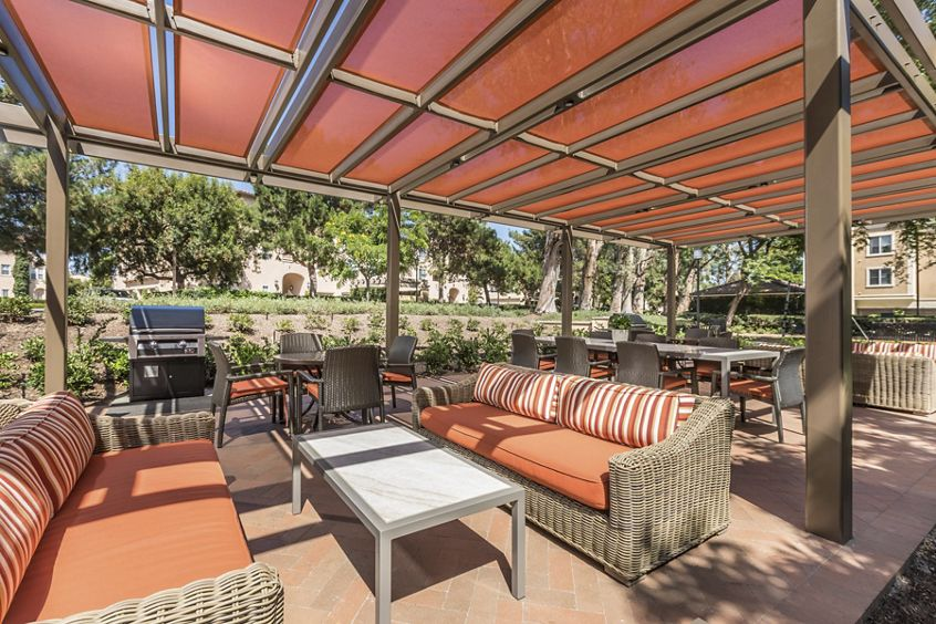 Exterior view of outdoor patio at Las Palmas Apartment Homes in Irvine, CA.