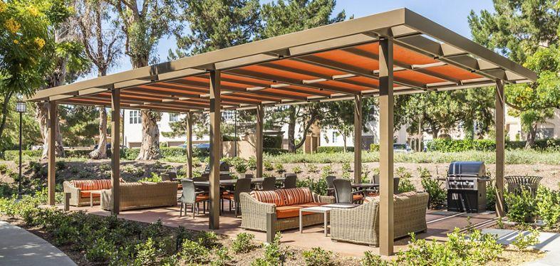Exterior view of outdoor patio at Las Palmas Apartment Homes in Irvine, CA.