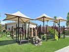 Exterior view of children's play area at Los Olivos Apartment Homes at Irvine Spectrum in Irvine, CA.