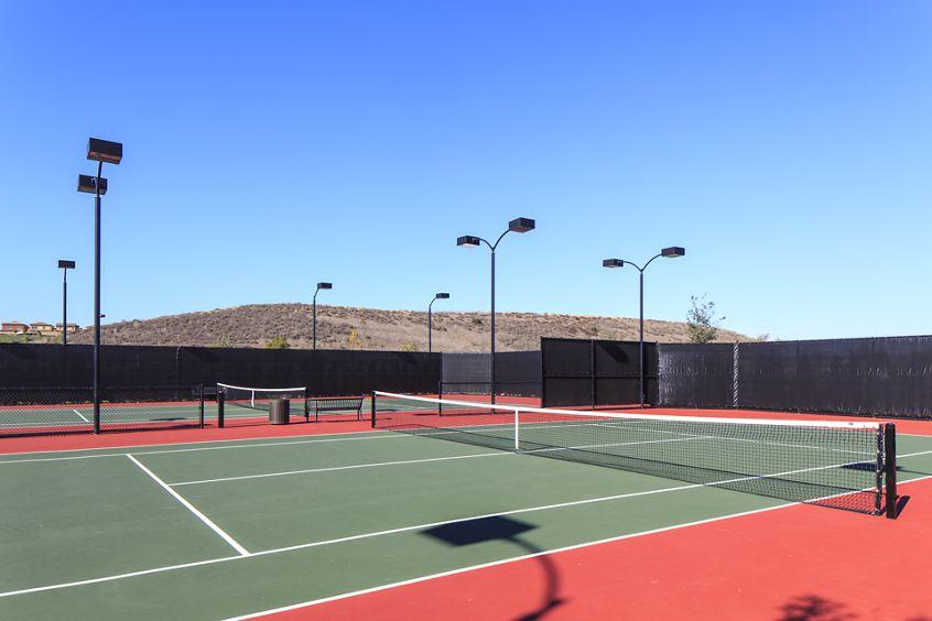 Exterior view of tennis court at Los Olivos Apartment Homes at Irvine Spectrum in Irvine, CA.