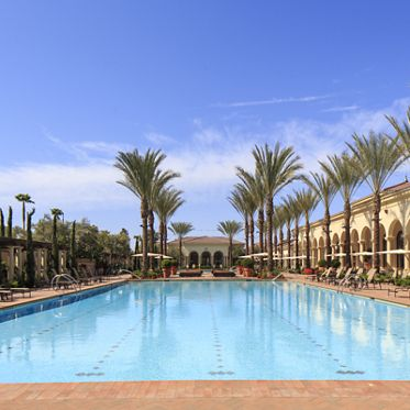 Exterior view of pool at Los Olivos Apartment Homes at Irvine Spectrum in Irvine, CA.