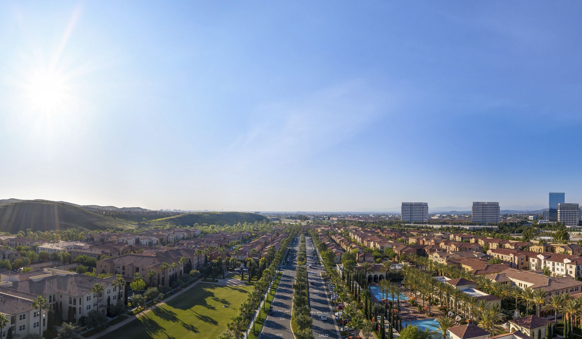 Exterior aerial panorama view of leasing center at Los Olivos at Irvine Spectrum Apartment Homes in Irvine, CA.