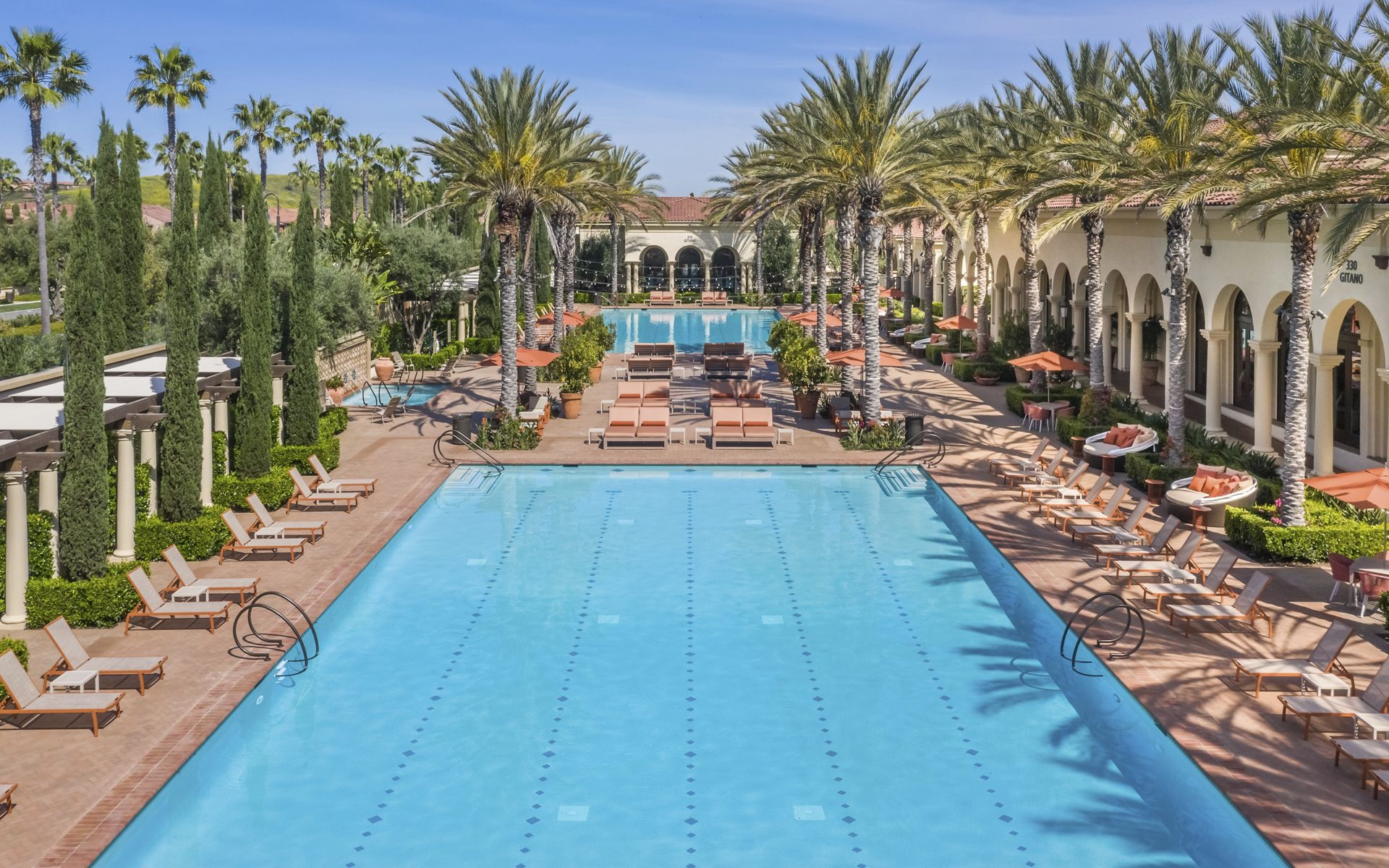 Exterior pool view at Los Olivos at Irvine Spectrum Apartment Homes in Irvine, CA.