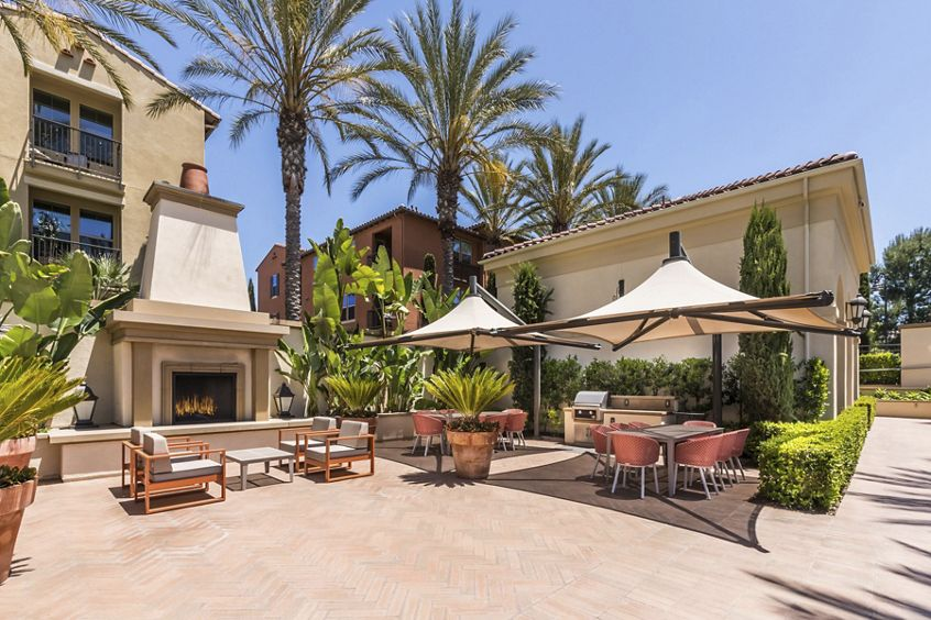 Exterior view of outdoor courtyard at Los Olivos at Irvine Spectrum Apartment Homes in Irvine, CA.
