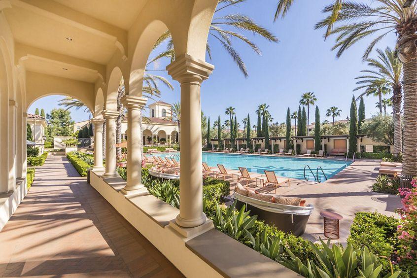 Exterior pool view at Los Olivos at Irvine Spectrum Apartment Homes in Irvine, CA.