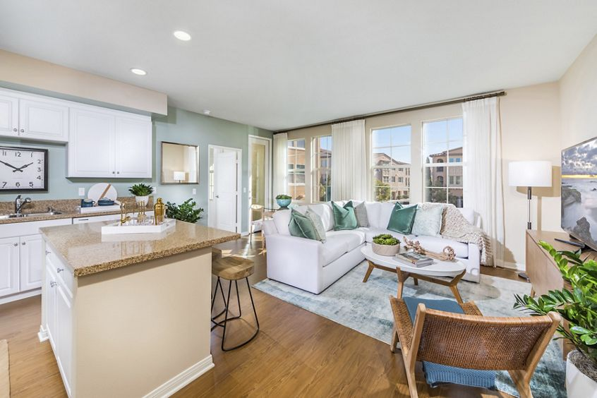 Interior view of living room and kitchen at Los Olivos Apartment Homes at Irvine Spectrum in Irvine, CA.