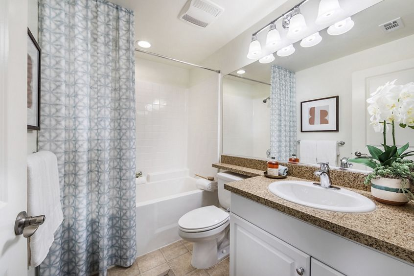 Interior view of bathroom at Los Olivos Apartment Homes at Irvine Spectrum in Irvine, CA.