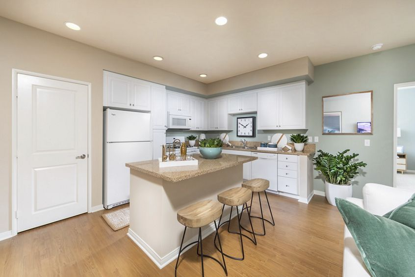 Interior view of kitchen at Los Olivos Apartment Homes at Irvine Spectrum in Irvine, CA.