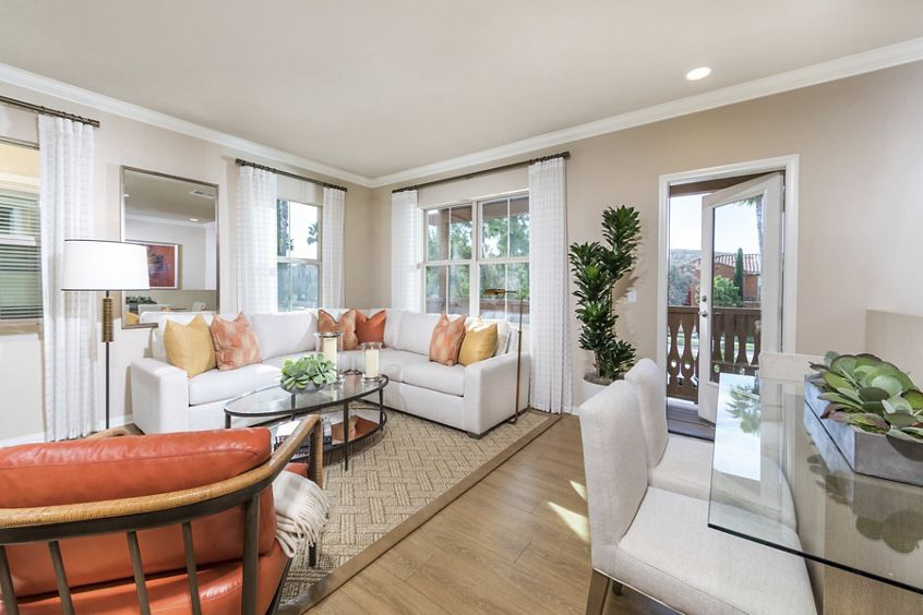 Interior view of living room and dining room at Los Olivos Apartment Homes at Irvine Spectrum in Irvine, CA.