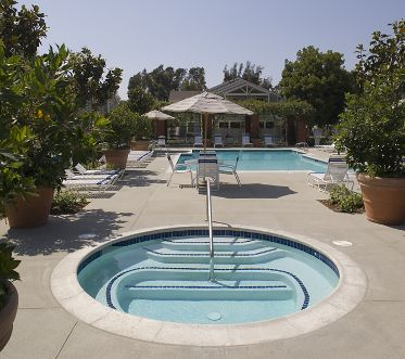 Exterior view of pool area at Northwood Park Apartment Homes in Irvine, CA.