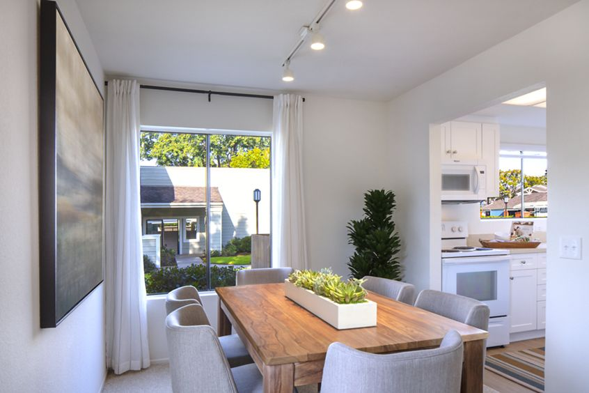 Interior view of dining room and kitchen at Northwood Park Apartment Homes in Irvine, CA.