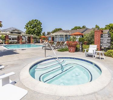 Exterior view of pool and spa at Northwood Park Apartment Homes in Irvine, CA.