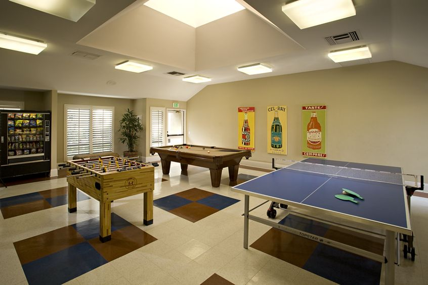 Interior view of game room at Northwood Place Apartment Homes in Irvine, CA.