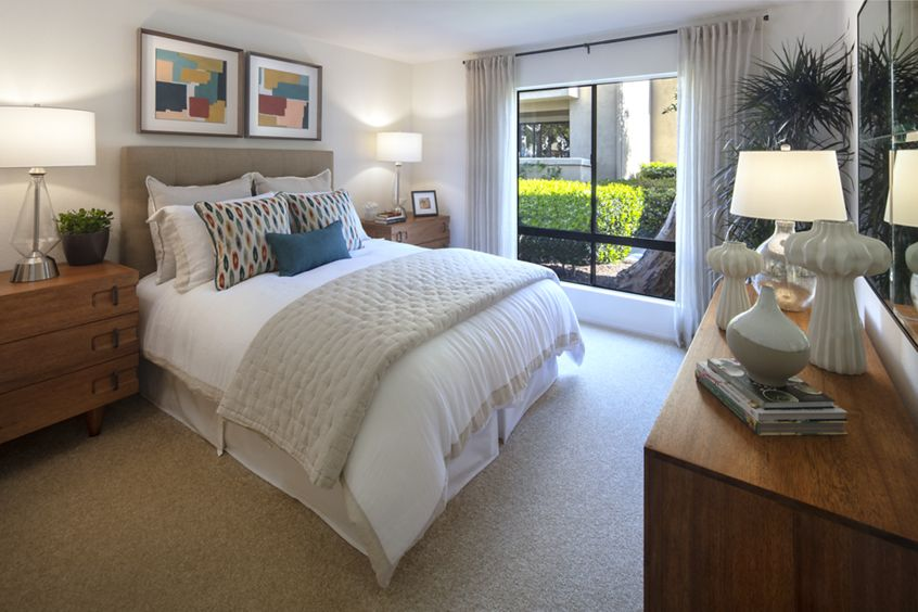 Interior view of bedroom at Northwood Place Apartment Homes in Irvine, CA.