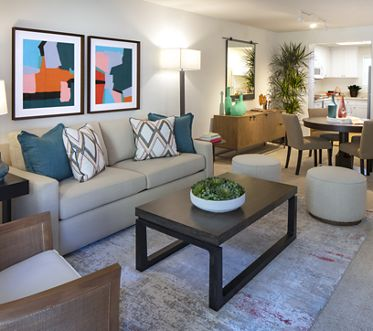 Interior view of living room and dining room at Northwood Place Apartment Homes in Irvine, CA.