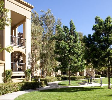 Exterior view of Oak Glen Apartment Homes in Irvine, CA.
