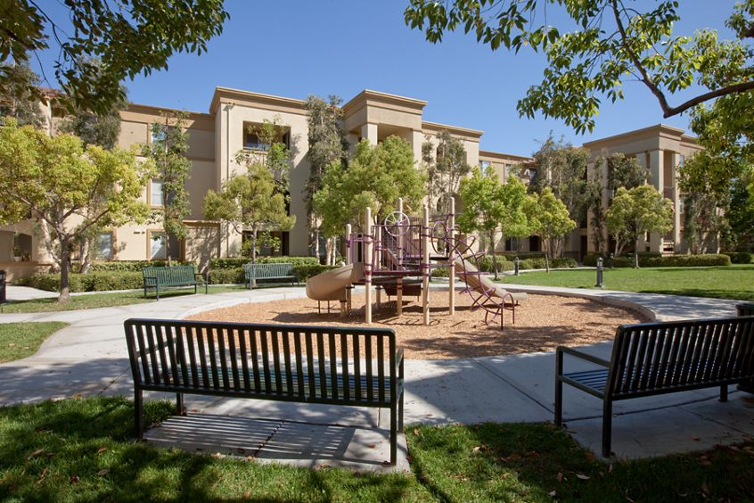 Exterior view of children's play area at Oak Glen Apartment Homes in Irvine, CA.