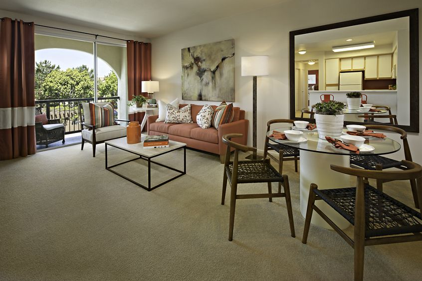 Interior view of living room and dining room at Oak Glen Apartment Homes in Irvine, CA.