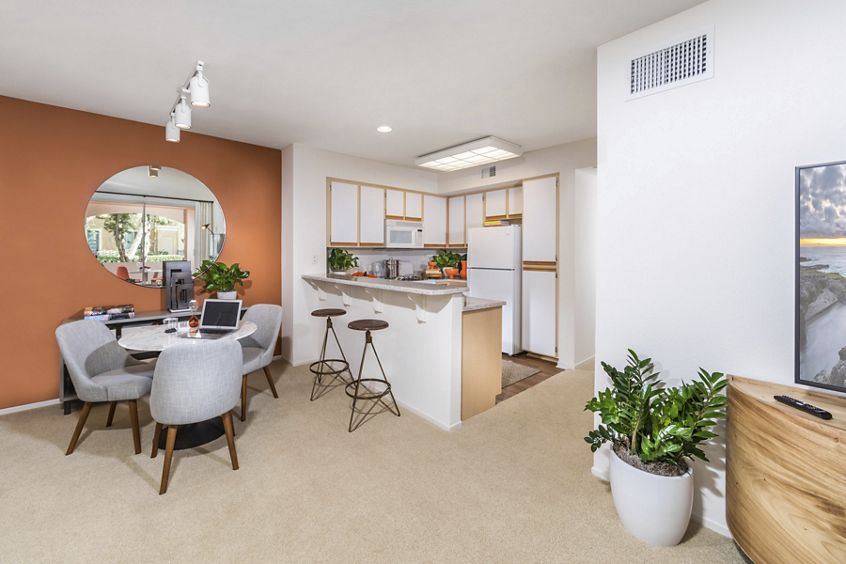 Interior view of kitchen and dining room at Oak Glen Apartment Homes in Irvine, CA.