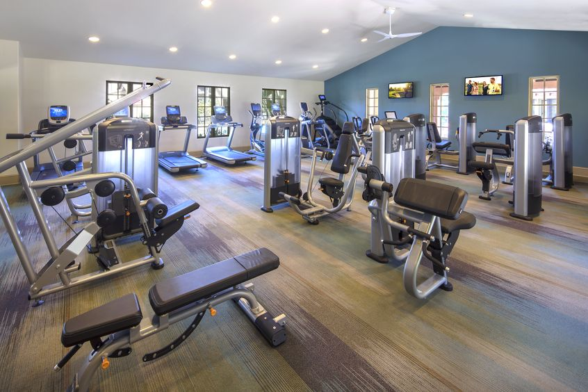 Interior view of fitness center at Orchard Hills Apartment in Irvine, CA.