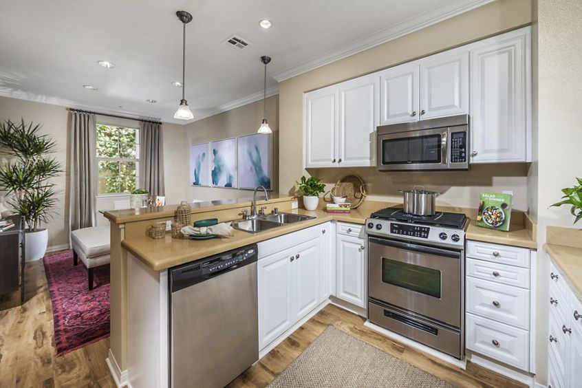 Interior view of kitchen at Orchard Hills Apartment Homes in Irvine, CA.