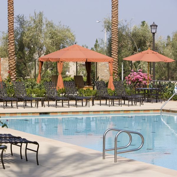 Exterior view of pool area at Orchard Hills Apartment Homes in Irvine, CA.