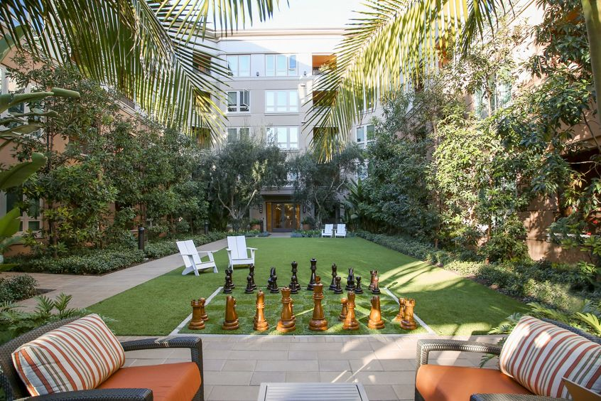 Exterior view of giant chess game in courtayard at Park Place Apartment Homes in Irvine, CA.