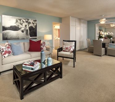 Interior view of living room and dining room at Parkwood Apartment Homes in Irvine, CA.