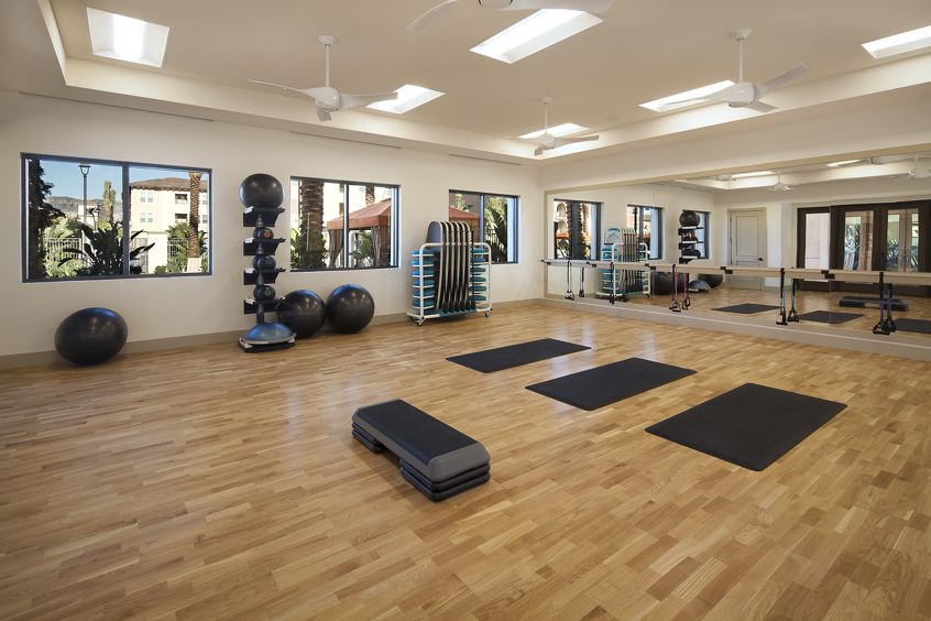 Interior view of fitness center at Portola Court Apartment Homes in Irvine, CA.