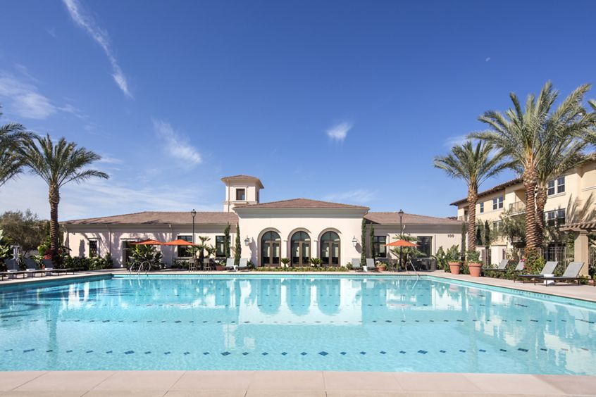 Exterior view of pool at Portola Court Apartment Homes in Irvine, CA.