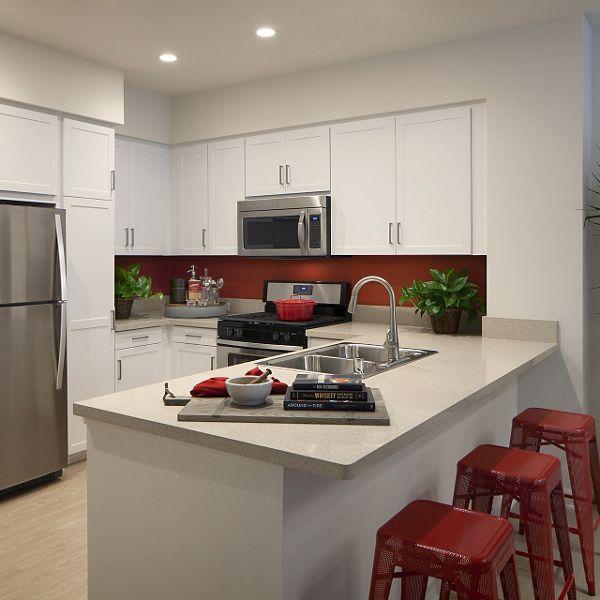 Interior view of kitchen at Portola Court Apartment Homes in Irvine, CA.