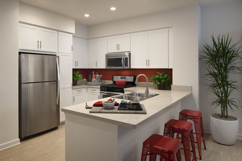 Interior view of kitchen at Portola Court Apartment Homes in Irvine, CA.