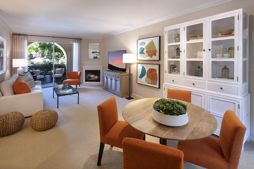 Interior view of dining room and living room at Portola Place Apartment Homes in Irvine, CA.
