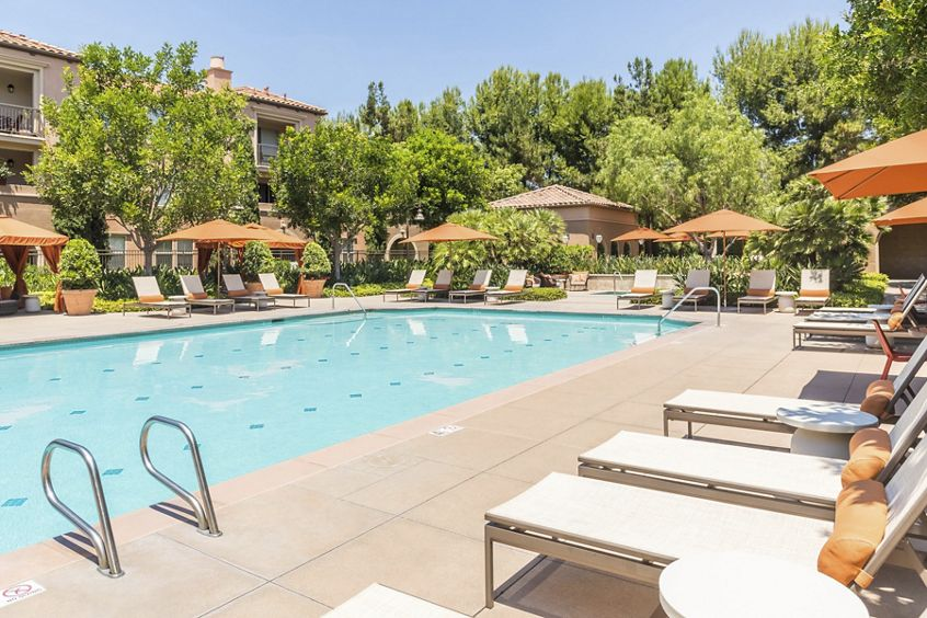 Exterior pool view at Portola Place Apartment Homes in Irvine, CA.