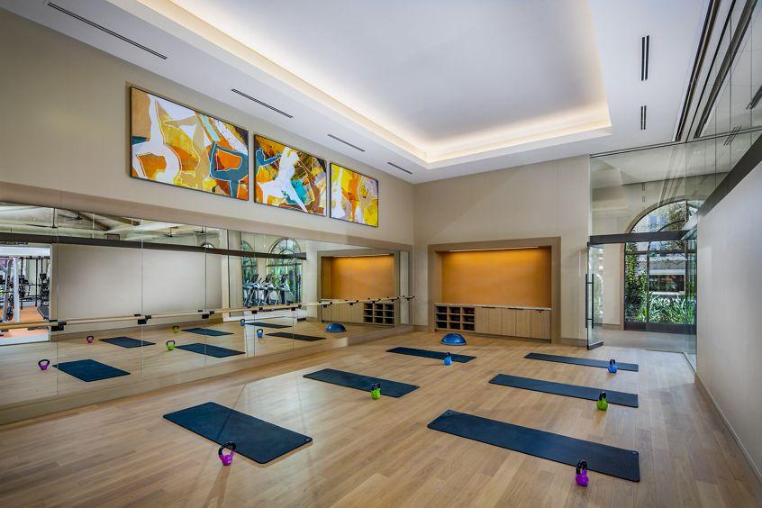 Interior view of yoga room at Promenade Apartment Homes in Irvine, CA.
