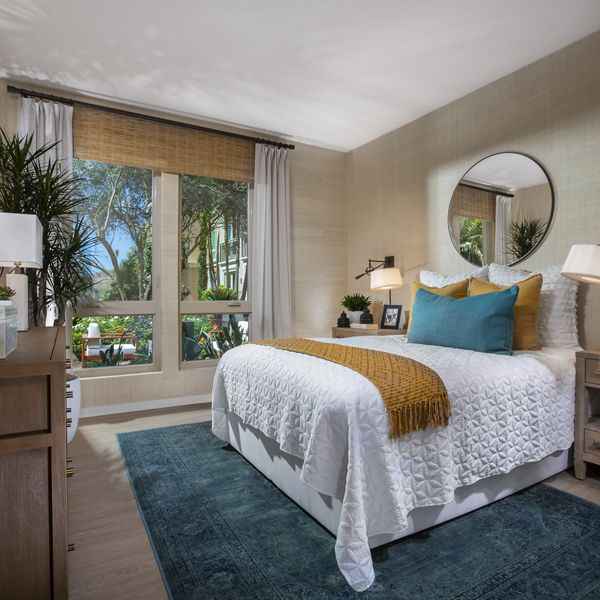 Interior view of bedroom at Promenade Apartment Homes in Irvine, CA.