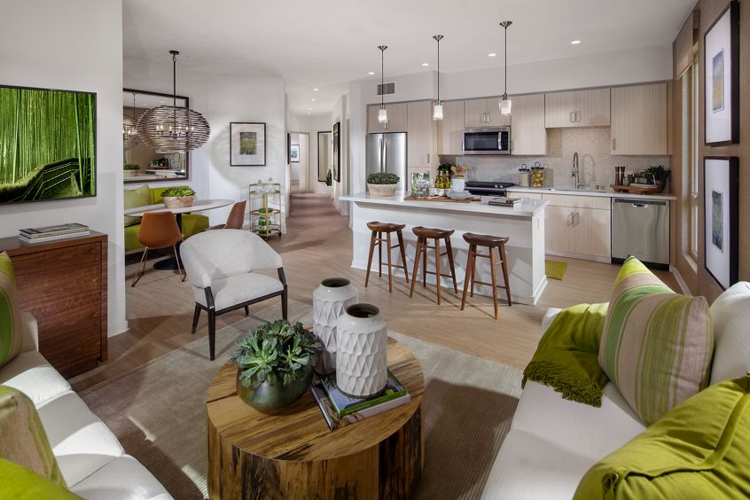 Interior view of kitchen and living room at Promenade Apartment Homes in Irvine, CA.