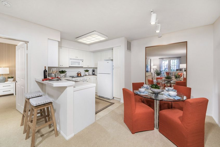 Interior view of kitchen and dining room at Quail Hill Apartment Homes in Irvine, CA.
