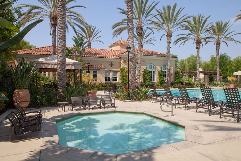 Exterior view of pool and lounge area at Quail Ridge Apartment Homes at Quail Hill in Irvine, CA.