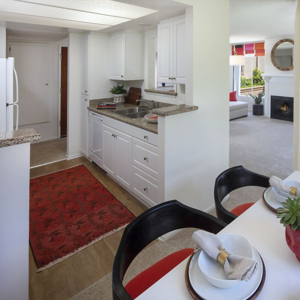 Interior view of kitchen and dining room at Rancho San Joaquin Apartment Homes in Irvine, CA.