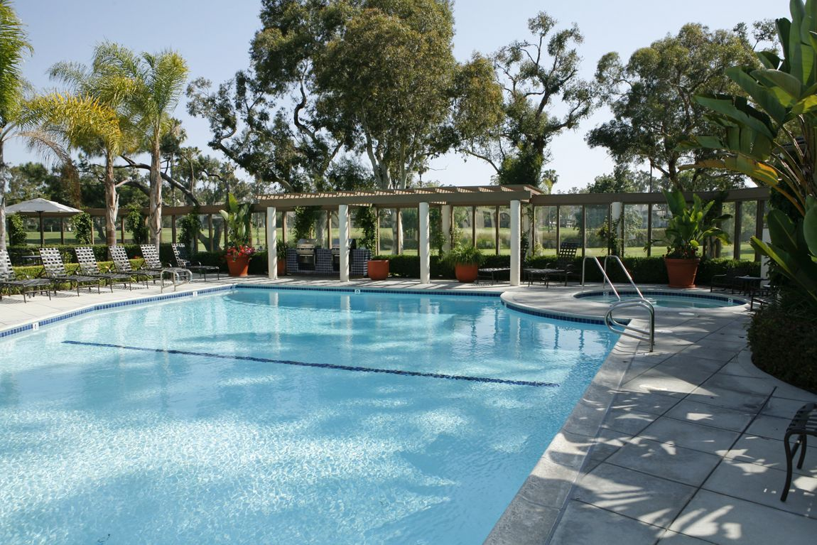 Exterior view of pool at Rancho San Joaquin Apartment Homes in Irvine, CA.