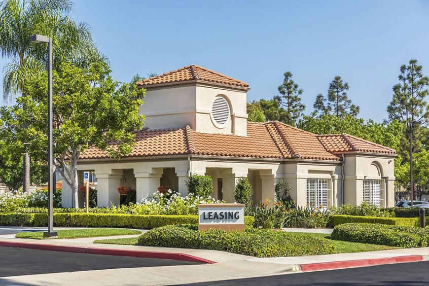 Exterior view of leasing center at San Carlo Villa Apartment Homes in Irvine, CA.
