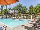 Daytime pool view of San Carlo Villa Apartment Homes in Irvine, CA.