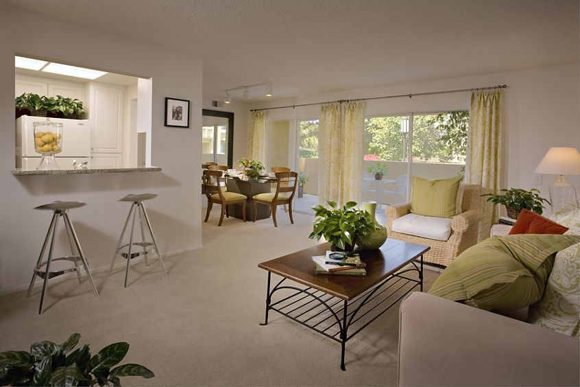 Interior view of living room, dining room, and kitchen at San Leon Villa Apartment Homes in Irvine, CA.