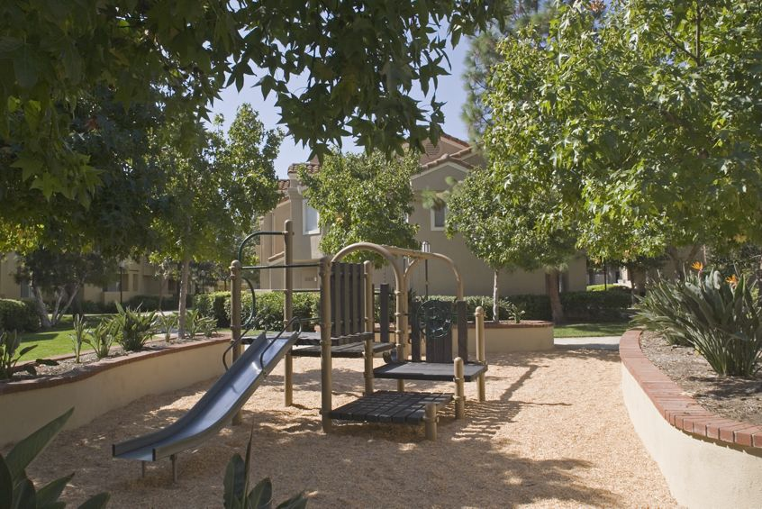 Exterior view of children's play area at San Marco Villa Apartment Homes in Irvine, CA.