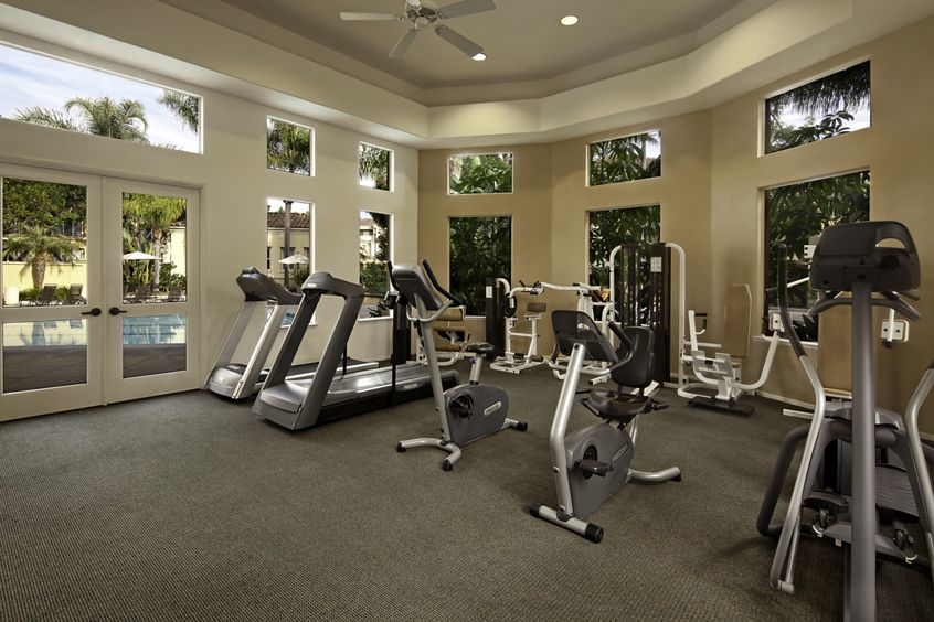 Interior view of fitness center at San Paulo Apartment Homes in Irvine, CA.