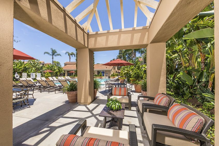 Exterior view of outdoor patio near the pool at San Remo Villa Apartment Homes in Irvine, CA.
