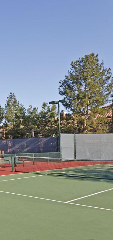 Exterior view of tennis courts at Santa Clara Apartment Homes in Irvine, CA.